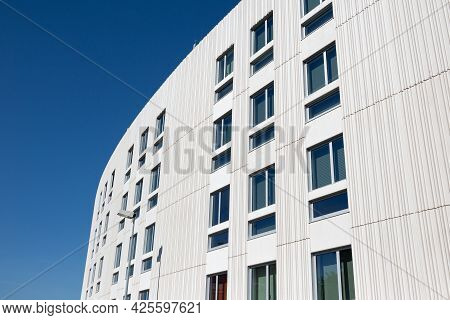 Modern Apartment Building With Decorative Grooved Concrete Facade. Copy Space