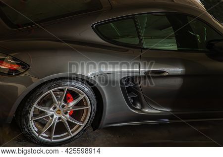 Bangkok, Thailand - 26 Jun 2021 : Side View Of Porsche Sports Car Parked In The Parking Lot. Selecti