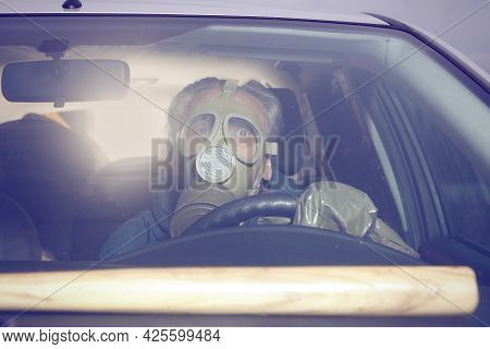 Man In Hazy Gas Mask Driving His Car To Avoid Infection