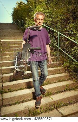 Older Man Overcoming Obstacles With His Four Wheel Rollator Walker