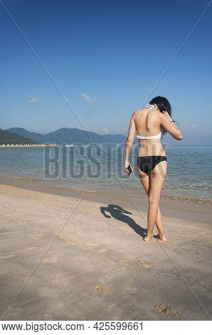 A Woman Wearing A Bikini On The Long Beach In Batu Ferringhi Penang Malaysia.