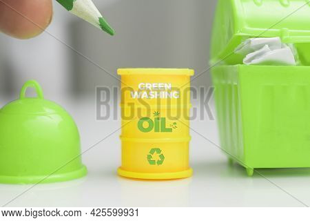 Greenwashing Concept. Oil Barrel With Recycle Symbol And Green Text. Greenwashing Is A Communication