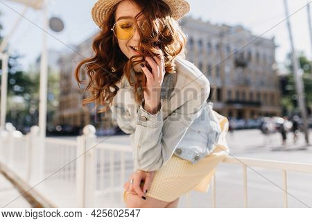Good-humoured Ginger Girl In Romantic Attire Posing On The Street. Outdoor Shot Of Caucasian Red-hai
