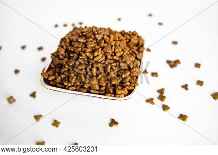 Dry Cat Food Top View. Dry Feed Pellets On White Background.