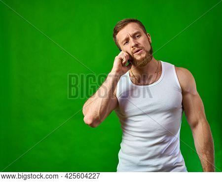 Caucasian Man Talking On The Phone. Serious Talk. Happy Man Talking On The Phone With A Smile. Stron