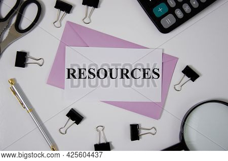 The Resources Text Is Written On Pink Envelope Near Office Suppliesr