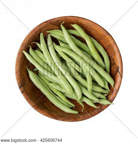 A Group Of Green Bean Pods In A Wooden Bowl Isolated Over White Background.