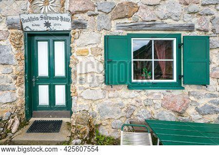 Dachstein, Austria - 09.23.2018: Green Door And Window Of Sudwand Hutte In The Hoher Dachstein Area