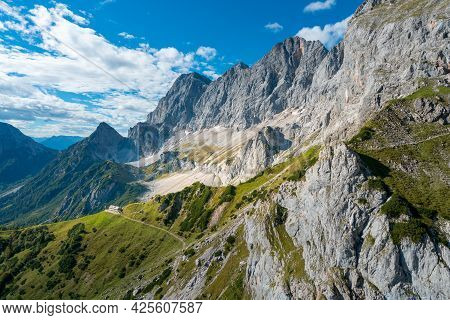 View Of Sudwand Hutte And Hoher Dachstein Massif On A Sunny Summer Day From A Cable Way. Steep Rocky