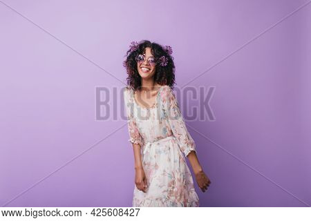 Slim Inspired African Girl Laughing During Studio Photoshoot. Indoor Photo Of Enthusiastic Curly You