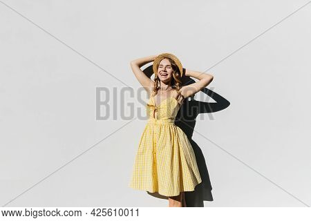 Gorgeous Slim Lady In Hat Posing In Sunny Day And Laughing. Outdoor Shot Of Good-humoured Female Mod