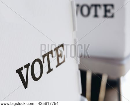 Closeup of white polling booth