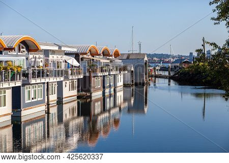 Cute, Colourful Floating Houseboats Line The Docks In Mosquito Creek Marina, North Vancouver, Britis