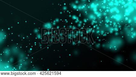 Glowing blue particles floating upwards on a dark background. light, colour, energy and movement concept, digitally generated image.