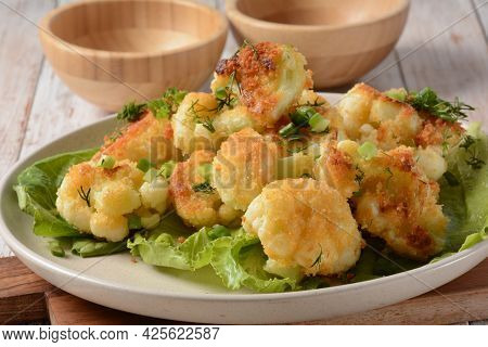 Fried Cauliflower Florets In Batter On A White Plate. Coated Fried Cauliflower
