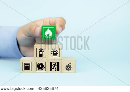 Fire, Hand Choose Cube Wooden Toy Block Stack With Prevent Icon With Fire Extinguisher And Door Exit