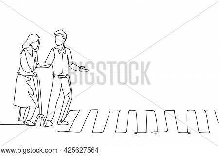 Continuous One Line Drawing A Young Man Helps An Old Grandmother Who Uses A Cane To Cross The Road O
