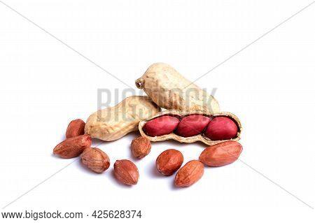 Peeled Peanuts And Peanut Pod Isolated On White Background.