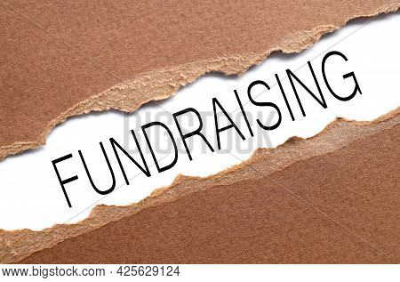 Fundraising. Text On Torn Paper. Test In Black Letters