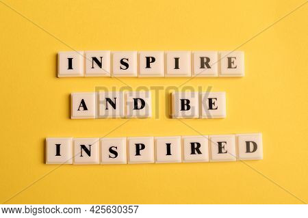 Square Letters With Text Inspire And Be Inspired Isolated On Yellow Background