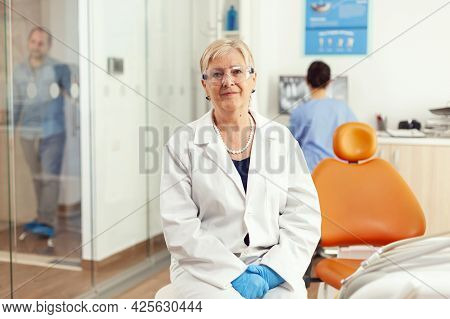 Stomatological Doctor Looking Into Camera While Waiting For Pacient Examination In Hospital Dental R
