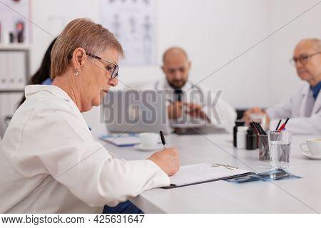 Hospital Physician Doctors Working At Medical Expertise Presentation Prescribing Pills Medication Si