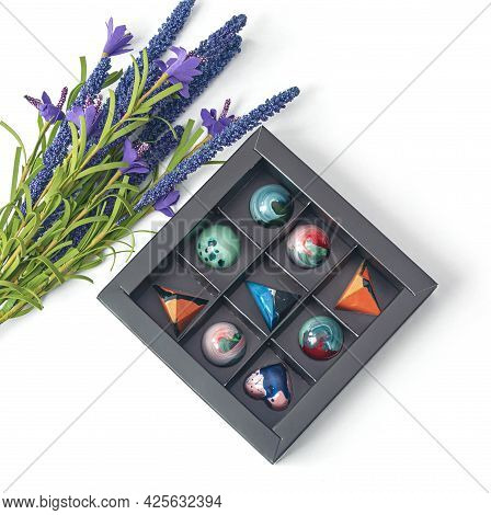 Tempered Chocolate Candies With Glossy Painted Body In A Box With Blur Elements. View From Above. St