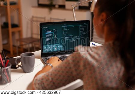 Female Hacker Sitting In Front Of Computer And Thinking How To Fraud The Government At Night Time. P