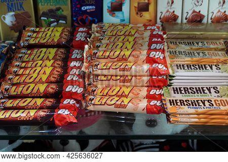 Lion White, Hersheys Chocolates Candy Bar Displayed On A Shelf Inside A Supermarket. Chocolate Sweet