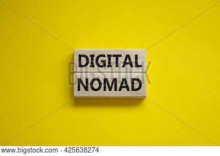Digital Nomad Symbol. Wooden Blocks With Words Digital Nomad On Beautiful Yellow Background, Copy Sp