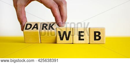 Dark Web Symbol. Businessman Turns Wooden Cubes And Changes The Word Web To Dark Web. Beautiful Yell
