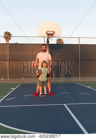 Happy Daddy And Son Play Basketball With Ball On Playground, Happy Family