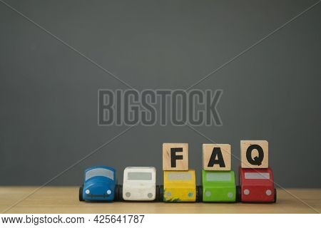 Faq The Word Is Written On Wooden Cubes Placed Roof Of Car.