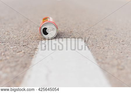 Aluminum Can Is Flat Lay,lying On The Road. Can Fall On The Street, It Can Be Recycled.summer Day Bl