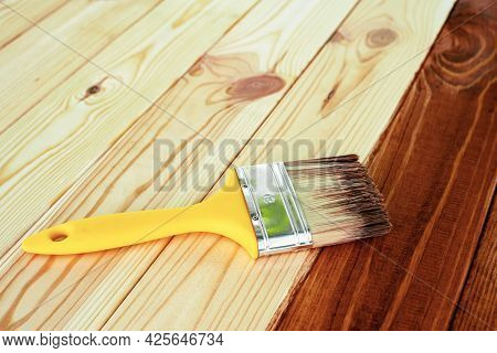 Wood Staining. Brush. Painting Wooden Patio Deck With Protective Varnish