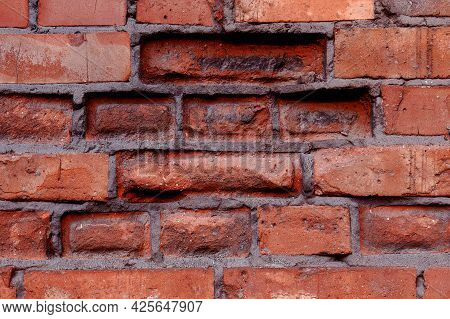 Empty Old Red Brick Wall Texture. Painted Distressed Wall Surface. Grungy Wide Brickwall. Grunge Red