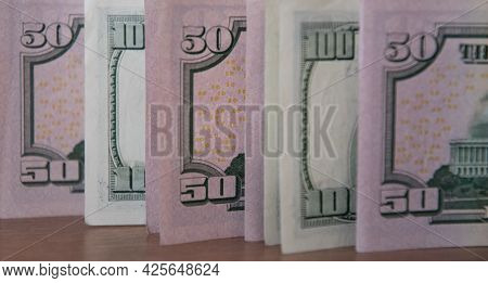 Close-up Fifty Dollar Bills And One Hundred Dollar Bills Styled By Retro Tinting. Details Of Us Curr
