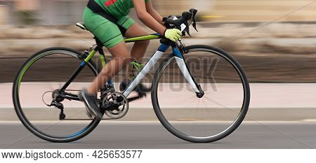 Cycling Rider Competing In The Youth Class, Motion Blur Of A Bike Race With The Bicycle And Rider At