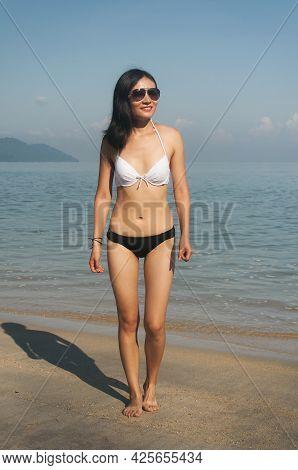 A Happy Chinese Woman Wearing A Bikini On Long Beach In Batu Ferringhi On A Sunny Summer Day In Pena