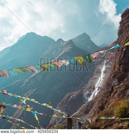 Blurred Nature Mountain Background. Prayer Buddhist Flags Fluttering In The Wind. Nepal, Himalaya