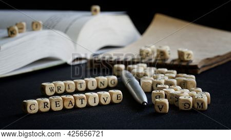Creative Writing Next To Open Textbook, Notepad And Fountain Pen. The Concept Of Teaching Creative W