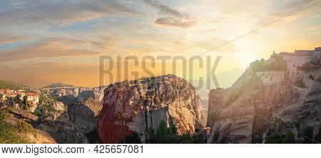 Meteora Rocks And Monastery At Sunset In Greece