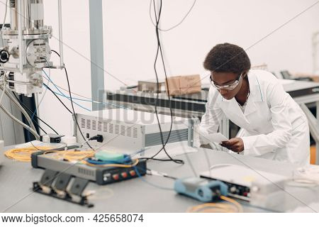 Scientist African American Woman Work In Laboratory With Electronic Tech Single Photon Detector. Res