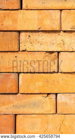 A Stack Of Stacked Red Bricks. Start Of Construction. Material For Construction Work. Laying The Fir