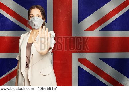 Prevention Of Coronavirus Covid-19 And Sars Cov 2 And Coronavirus Disease In Uk Concept. Woman In An
