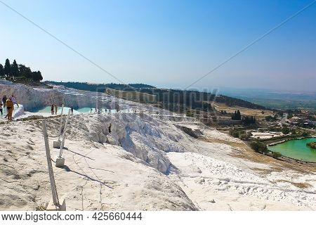 Travertines In Turkey. Calcite Cliff Of Pamukkale At Sunny Day