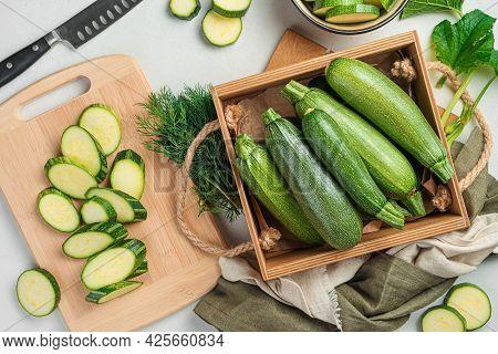Preparation Of Zucchini. Ripe Zucchini On A Gray Background.