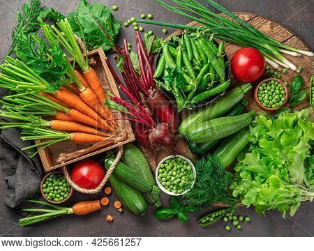 Ripe Vegetables And Herbs In A Large Assortment On A Brown Background. Top View. Healthy, Healthy Fo