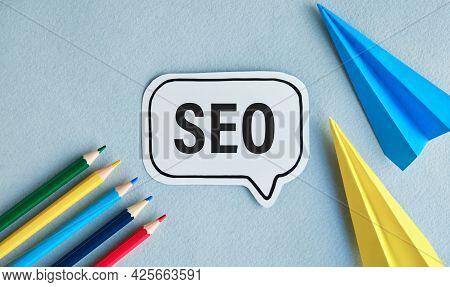 Seo Career. Opened Notebook With Seo-optimization Scheme Lying Over Blue Office Table Background. Se