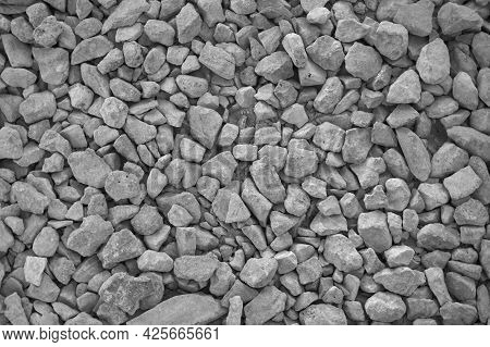 The Background Is Made Of Natural Gray Rubble. Broken Stone, Building Material. The Texture Of Grani